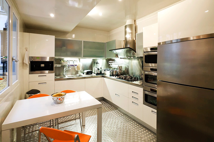 Villa features a full white-lacquered gourmet kitchen